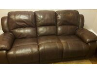 Real leather reclining three seater sofa