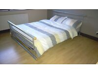 Silver coloured Double bed frame with wooden slots.