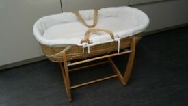 Moses basket with a rocking stand and a folding stand.