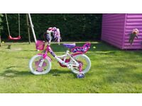 Girls Raleigh Bike Pink. Suit 3 to 6yrs. With stableisers