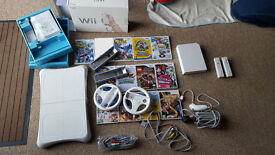 Nintendo Wii Console + 16x games + 2x Official controllers + 1x Nunchucks + 2x Steering wheels