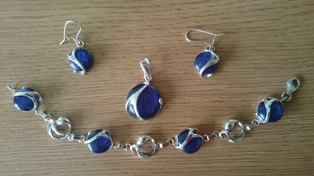 STERLING SILVER JEWELLERY (925in Salford, ManchesterGumtree - Hello, here I have a set of silver jewellery (925), which consists of a pendant, bracelet and ear rings. It is in a nice silver box and it is ideal as a gift. It has never been used. Sorry but I dont remember what stone is that ( The stone is...