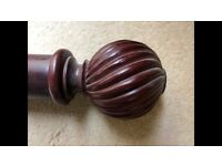dark wood set of curtain poles solid wood