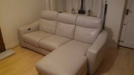Beautiful leather sofa with electric recliners.