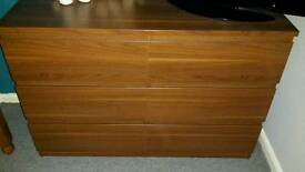 Dark wood double width chest of drawers and bedside cabinet