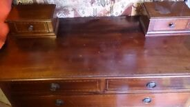 Edwardian period mahogany dressing table with two trinket drawers,