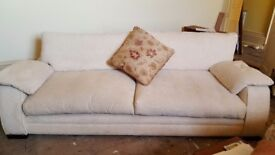 Beautiful large 4 seater sofa in a thick cream chenille fabric.