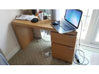Wooden desk, as seen on the photo.