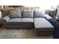 NEW Graded Right Hand Corner Sofa Bed in Grey Fabric With ottoman storage
