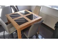 Solid wood with granite squares dining / kitchen table in very good condition
