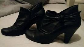 Leather black heel boots size 6