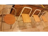 Five folding high chair for sale
