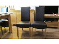 4 dark brown faux leather dining chairs