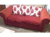 2/3 Seater Sofa in Red Fabric. Very comfy, smoke and pet free home.