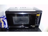 Black Hotpoint microwave SOLD