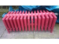 Victorian style red radiator, fully functioning.