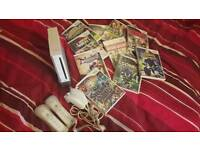 Wii with 2 remotes and nunchucks and 19 games