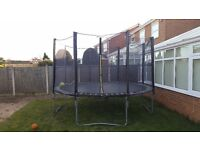 12 ft Activo trampoline in good condition with new surround net