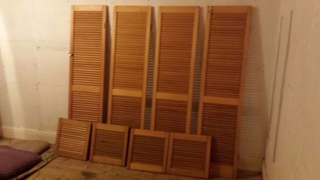 Wooden slatted louvre doors x 8, varnished and including handles ...