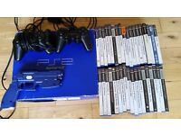 Playstation 2 boxed, 35 games, 6 controllers, gun, eye-toy, memory cards, region key