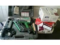 Hitachi Nail gun with three boxes of nails