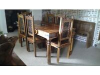 Dark indian jali wood dining table & 6 chairs. Very good condition.