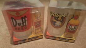 2 x simpsons collectable pint pots with bottle openers