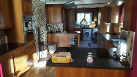 Schriber cherry Shaker style Kitchen including granite work tops and sink