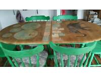 Beautiful table with 6 Annie Sloan shabby chic chairs