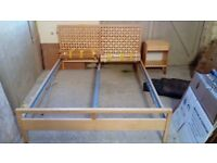King sized bed frame with slatted base and two matching bedside cabinets from Ikea