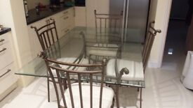 Glass top dining table and 6 chairs. Buyer collects