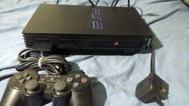 ps2 console with controller and supply