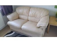 Cream leather two seater settee