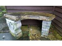 Stone curved garden bench weathered