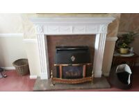 white plaster fire surround with marble back and hearth. also gas fire