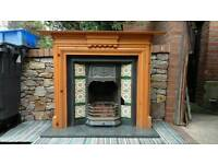 Cast iron fireplace insert with wooden mantle and granite hearth