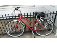 (Almost) Brand New Bicycle for Sale! A woman's red Ridgeback Meteor with locks / helmet / carry bag