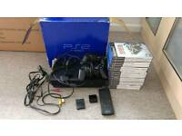 Boxed Sony Playstation 2 PS2 + games + controllers + remote