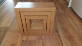 3 wooden cube shelves