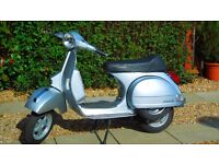 Vespa PX 125 standard except for sports exhaust