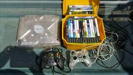 Clear Xbox plus 20 games and accessories.