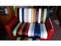 2 seater multi-coloured leather sofa and large footstool