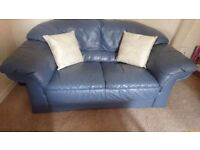 Almost new leather 2 seater sofa and armchair in blue