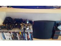 PS3 slimline with 31 games 6 controllers