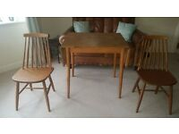 Retro formica extendable table and 2 Ercol style chairs in great condition £55