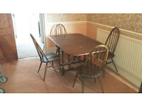 dark wood drop leaf table and 4 wood chairs gone pending pick up