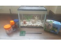 Fish aquarium with elite water filter, net, fish foods, aquarium decoration and gravel like new