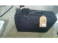 Black briefcase bought not used price tag still on it cost £22. Selling for £12. Thanks