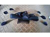 Black bow and feather fascinator.