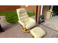Reclining and swiveling leather chair and matching foot stool in cream with light oak bases.